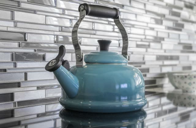 Kettle sitting on top of a bench in a refurbished kitchen