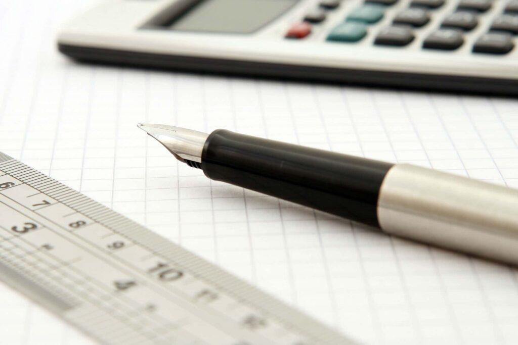 calculator -fountain pen- and paper